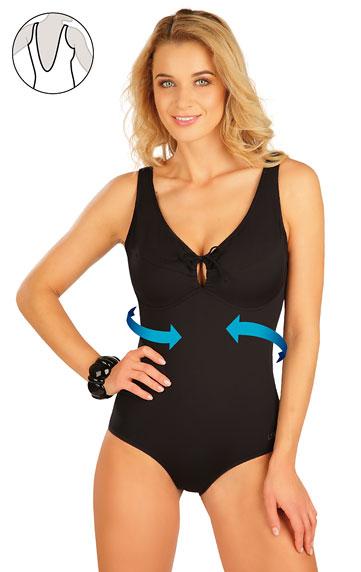Stahující jednodílné plavky s kosticemi.